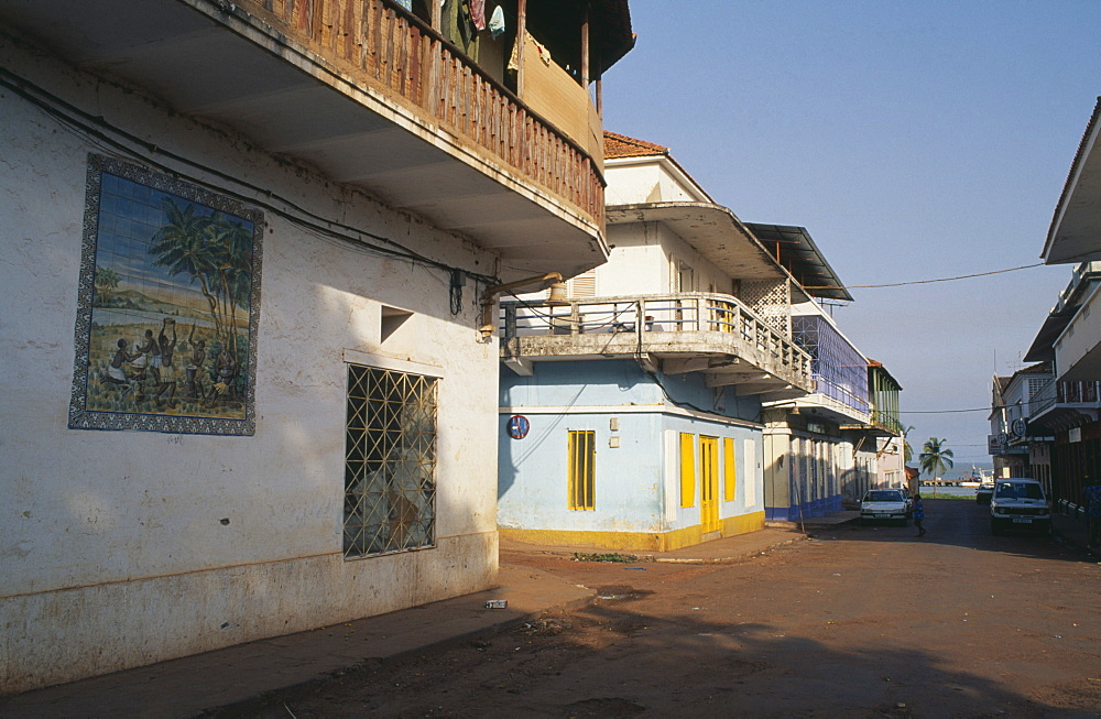 GUINEA BISSAU  Bissau Quiet street in the commercial area with mural painted on exterior wall of building in foreground.