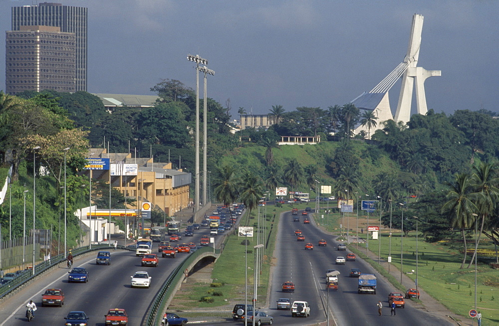 IVORY COAST  Abidjan Cityscape with multi-lane traffic and modern exterior of St Paul s Cathedral Côte d Ivoire  Cathédrale St-Paul