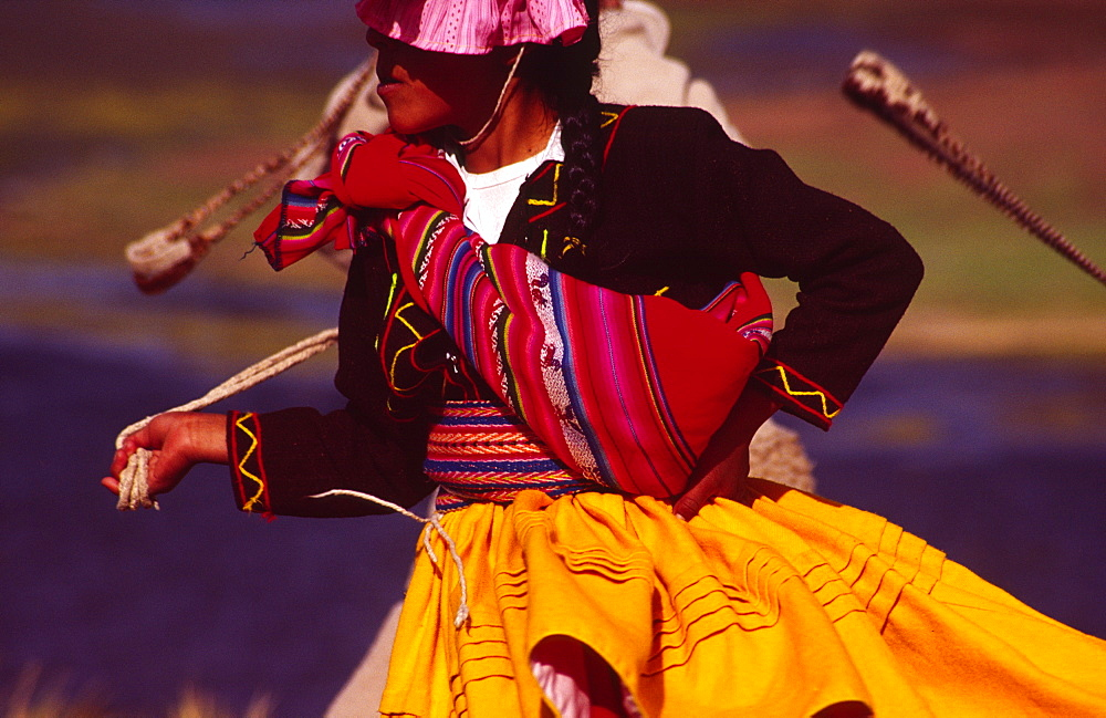 PERU Puno Administrative Department Lake Titicaca Aymara dancer dressed in her traditional costume  an Aymara girl performs a folk dance on the shore of Lake Titicaca Indigenous people