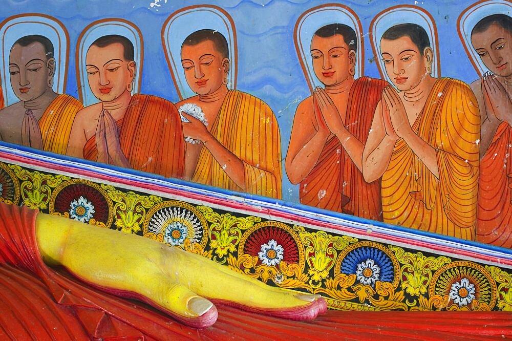 SRI LANKA  Anuradhapura Detail of the reclining Buddha in Isurumuniya Vihara  Rock Temple .  Sri Lanka travel Asia Buddha shrine Buddhism worship prayer faith Asian Llankai Sri Lankan  - 797-3790