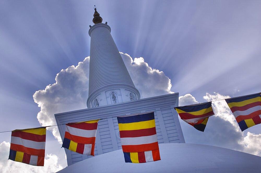 SRI LANKA  Anuradhapura Prayer flags hanging in front of Ruvanvelisaya Dagoba.  worship prayer Buddhism Buddha Asia Sri Lanka travel shrine faith Asian Llankai Sri Lankan  - 797-3793