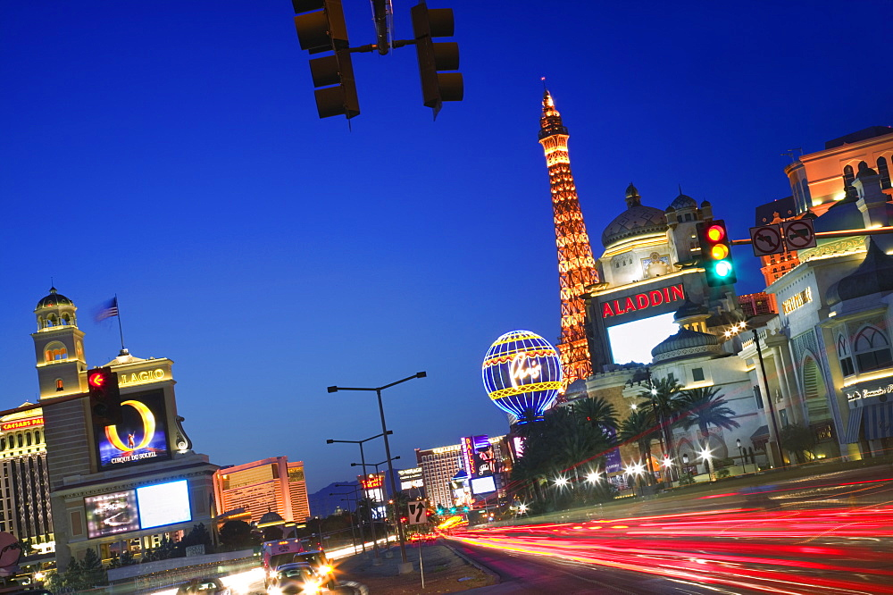 USA Nevada Las Vegas Las Vegas Boulevard  The Strip  at dusk. USA travel America The Strip entertainment twilight casino gambling Eiffel Tower temptation icon Las Vega American North America United States of America