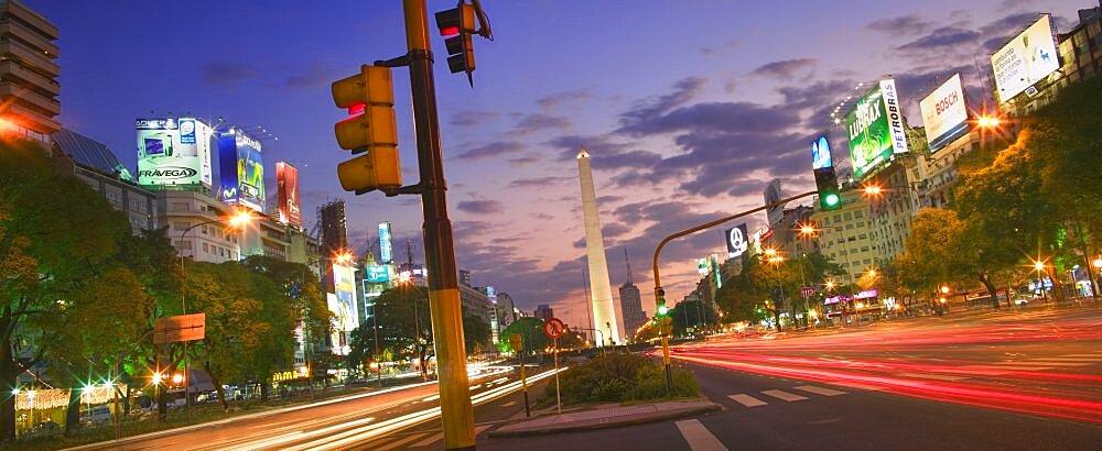 ARGENTINA  Buenos Aires View along Avenida 9 de Julio towards the Obelisco at dusk.  South America Latin America Travel Buenos Aires Av 9 de Julio panorama skyline Argentina icon American Argentinian Hispanic Latino