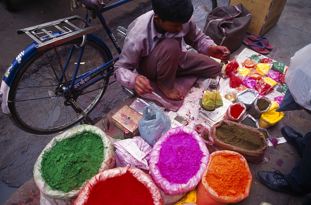 INDIA  Delhi Man with brightly coloured powdered paints for use during the Holi Festival. Asia Asian Bharat Colored Inde Indian Intiya Religion Religious  Asia Asian Bharat Colored Inde Indian Intiya Religion Religious  - 797-387
