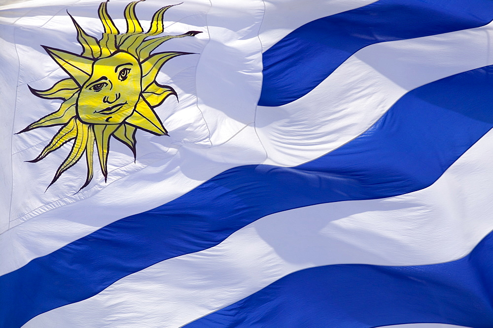 URUGUAY  Flag Close-up of the national flag of Uruguay. Travel South America Latin America. Emblem Sun Blue Uruguay Flag American Hispanic Latino   - 797-3926