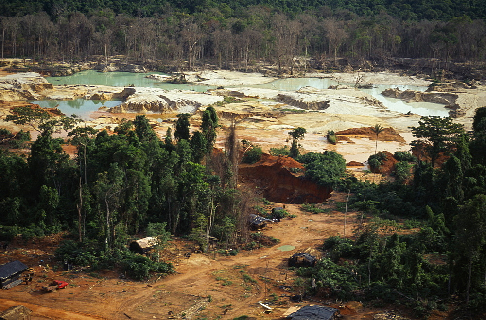 BRAZIL Mato Grosso Peixoto de Azevedo Garimpo  small scale gold mining  on former Panara territory showing deforestation and pollution. Garimpeiro prospectors in informal economy have displaced tribal Panara Indians formerly known as Kreen-Akrore  Krenhakarore  Krenakore  Krenakarore  Amazon American Brasil Brazilian Ecology Entorno Environmental Environment Green Issues Kreen Akore Latin America Latino Scenic South America  - 797-3958