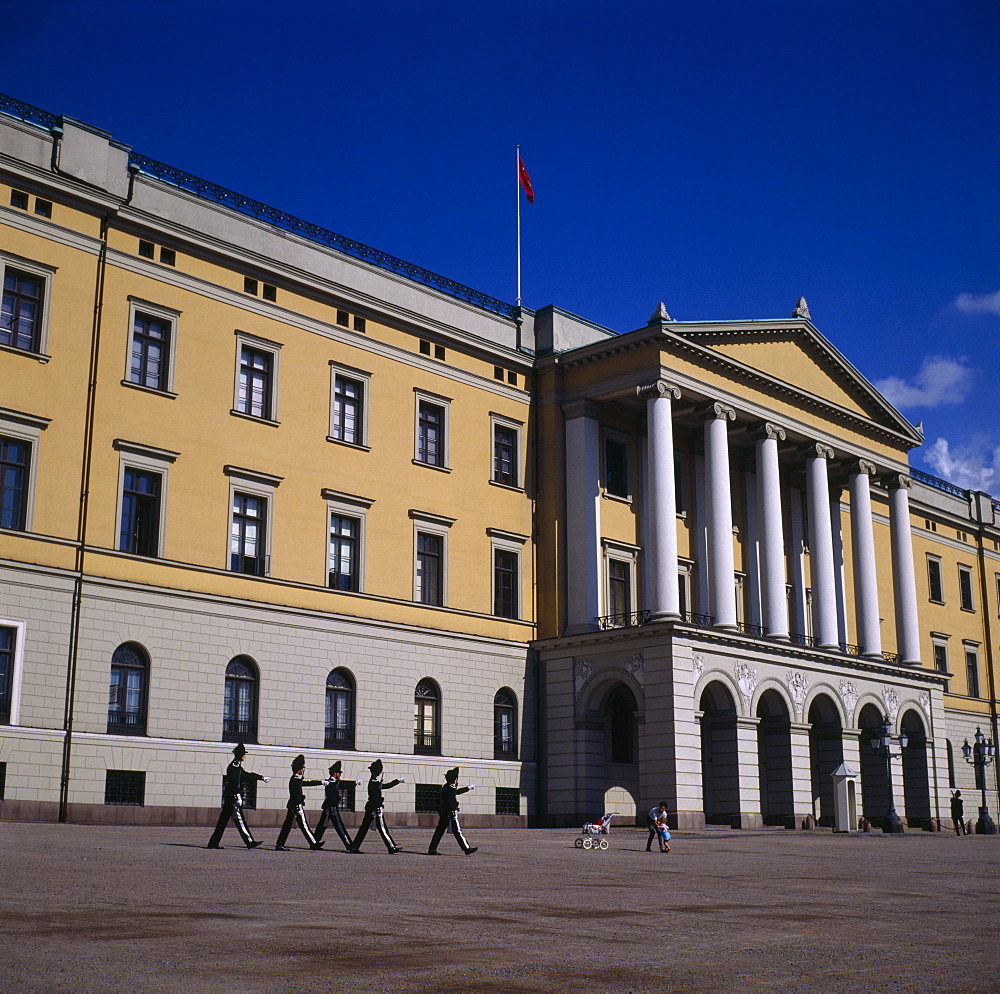 Royal Palace frontage with five guardsmen marching and sentry box, Oslo, Akershus, Norway
