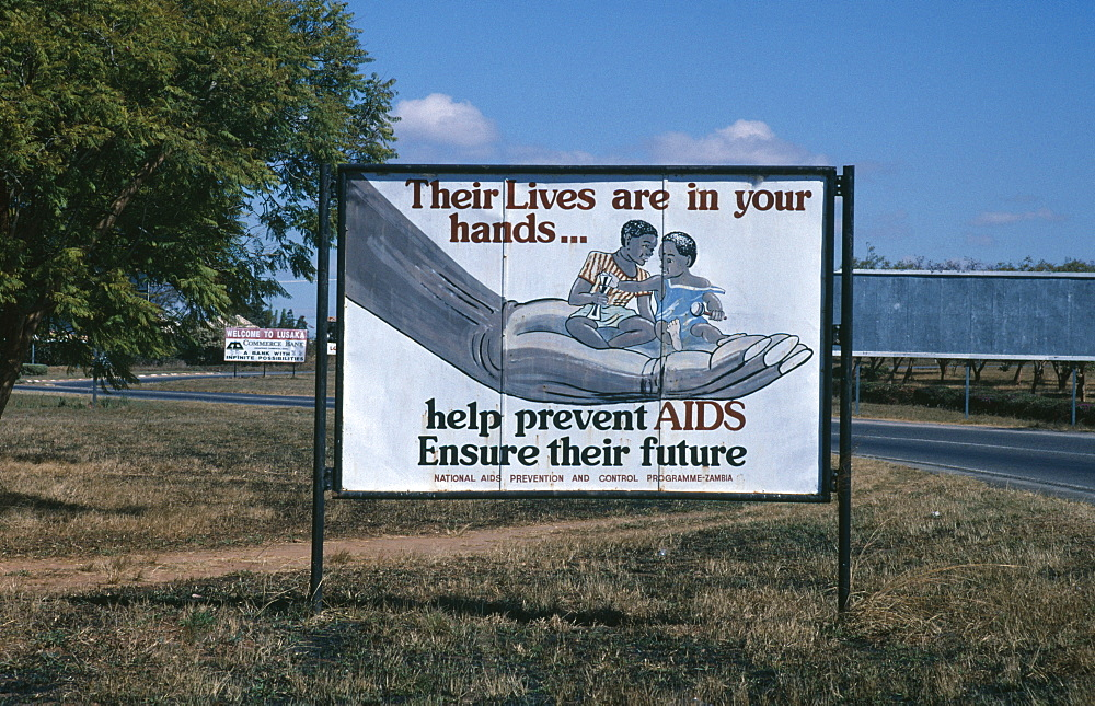 Billboard with AIDS prevention poster produced by the National Aids Prevention and Control Programme, Lusaka, Zambia