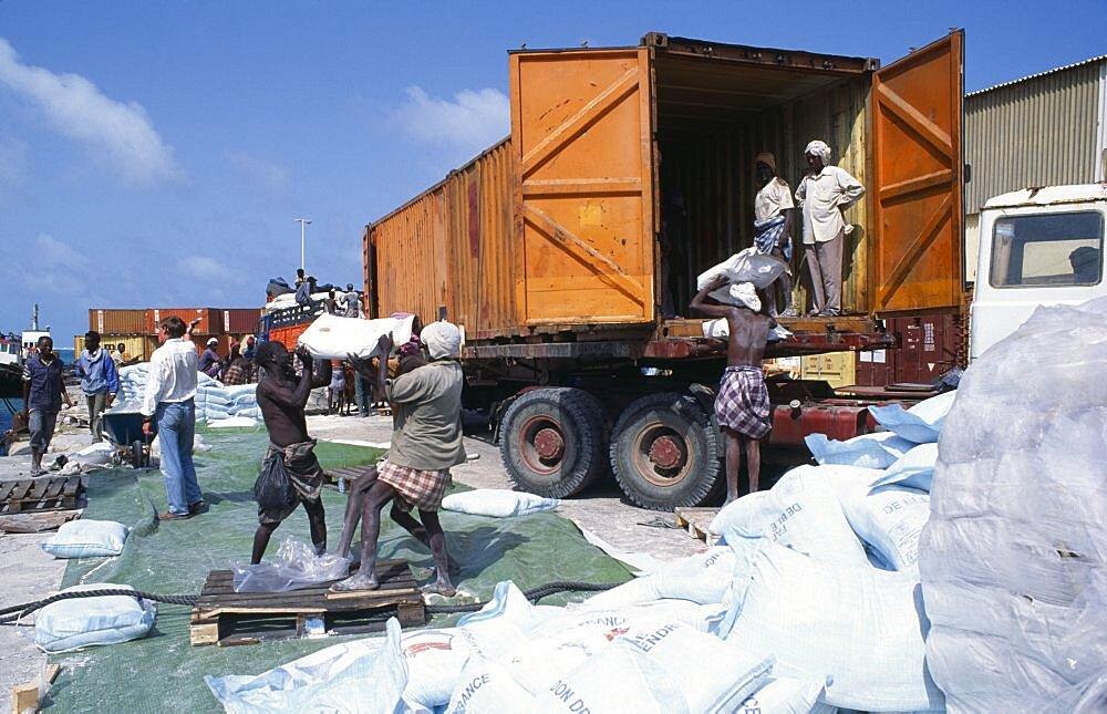 Loading French food aid of wheat flour onto truck for distribution from Mogadishu port, Mogadishu, Somalia, Africa