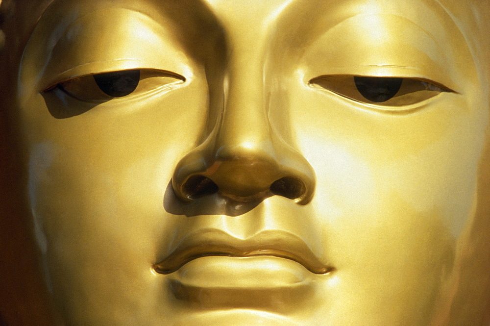 SRI LANKA  Colombo Close up of a Golden Buddha s face