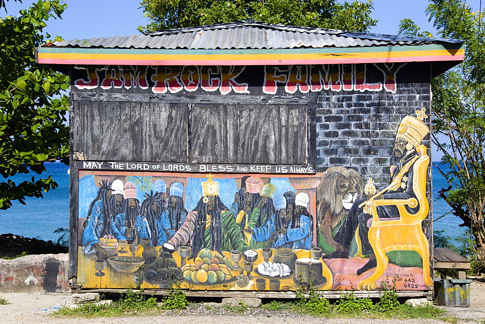 Colourful Rastafarian food hut called Jam Rock Cafe on the beach in Hillsborough decorated with a Rastafarian Last Supper and Emperor Haile Selassie, with the words May The Lord of Lords Bless and Keep Us Always, Grenada, West Indies, Caribbean, Central America