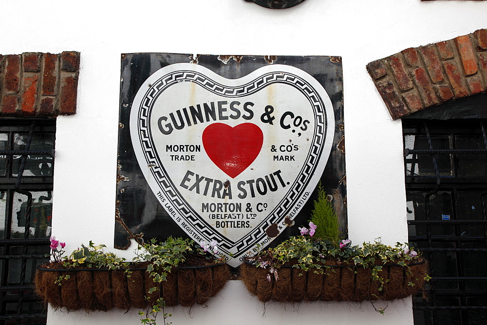 Cathedral Quarter Commerical Court Old metal Red Heart Belfast Bottled Guinness sign decorating the exterior of the Duke of York Public House, Northern Ireland