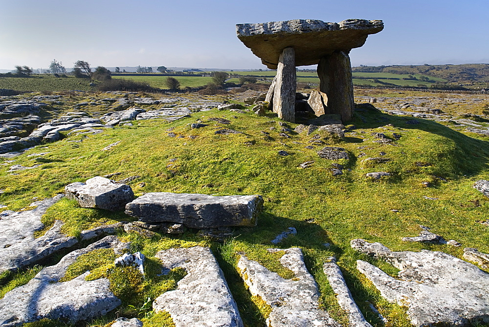 Ireland, County Clare, The Burren, Poulnabrone Dolmen - The thin capstone sits on two 18 metre (6 feet) high portal stones.