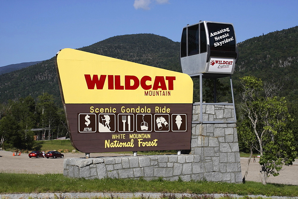 New Hampshire, USA, Wildcat Mountain ski area, Sign advertising scenic gondola cable car rides.