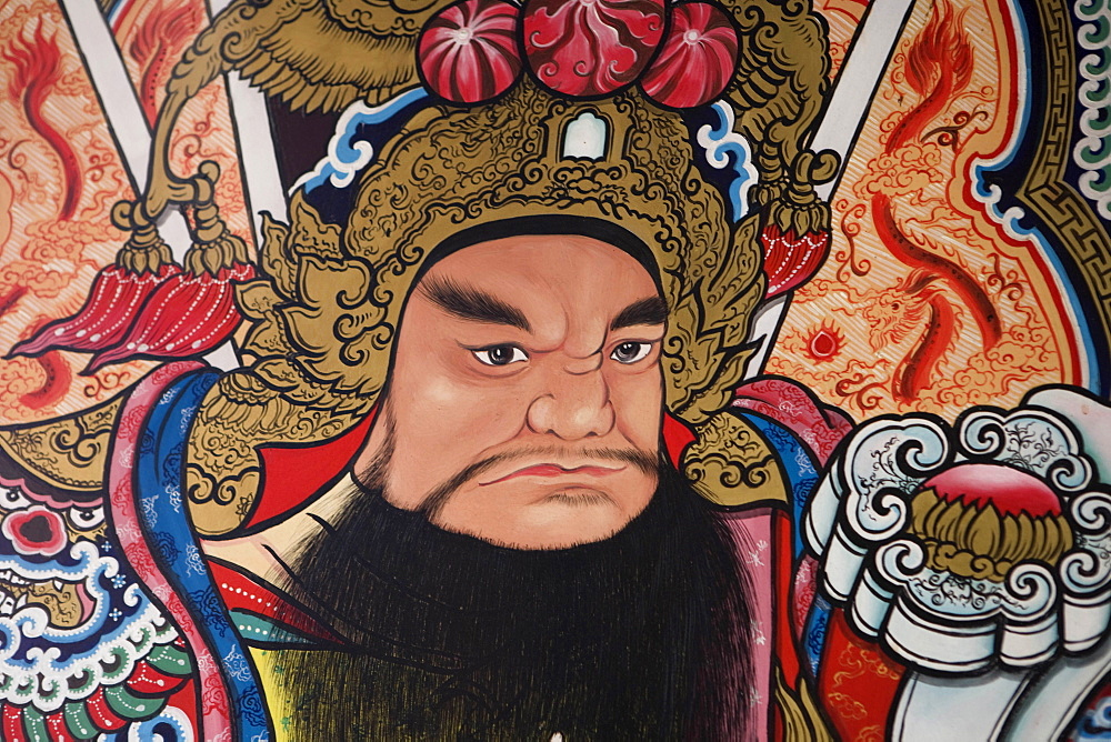 Thailand, Chiang Mai, Pung Tao Gong Ancestral Temple, Close up of a colourful mural depicting a male deity.