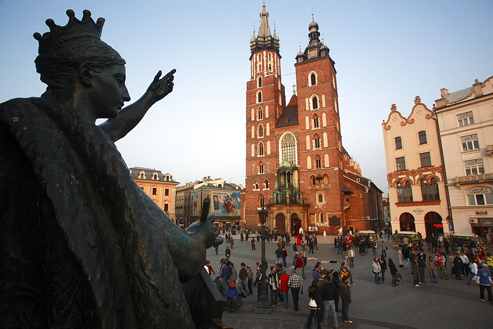 Poland, Krakow, Detail of female figure on monument to the polish romantic poet Adam Mickiewicz by Teodor Rygier in 1898 in the Rynek Glowny market square with Mariacki Basilica or Church of St Mary in the background