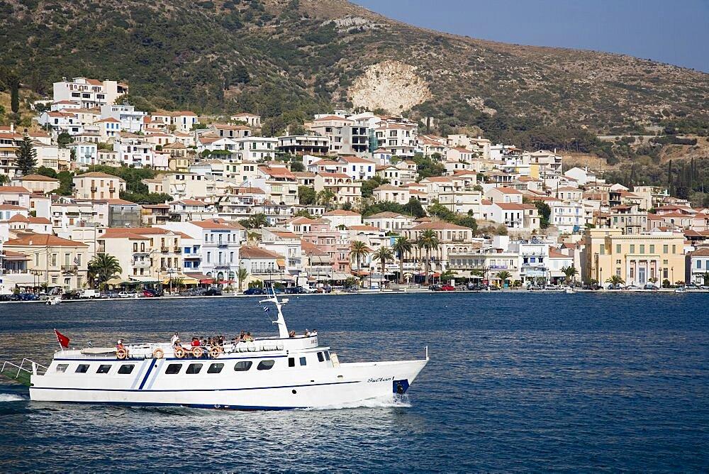 Greece, Northern Aegean, Samos, Vathy, ferry between Samos and Kusadasi in Turkey as it leaves Vathy Town houses spread across hillside behind