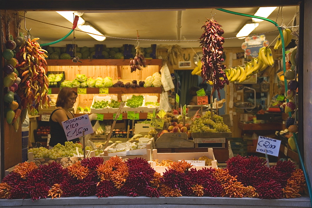 Italy, Veneto, Venice, Centro Storico, Local grocer with display of fresh fruit, vegetables and chillies Woman in interior