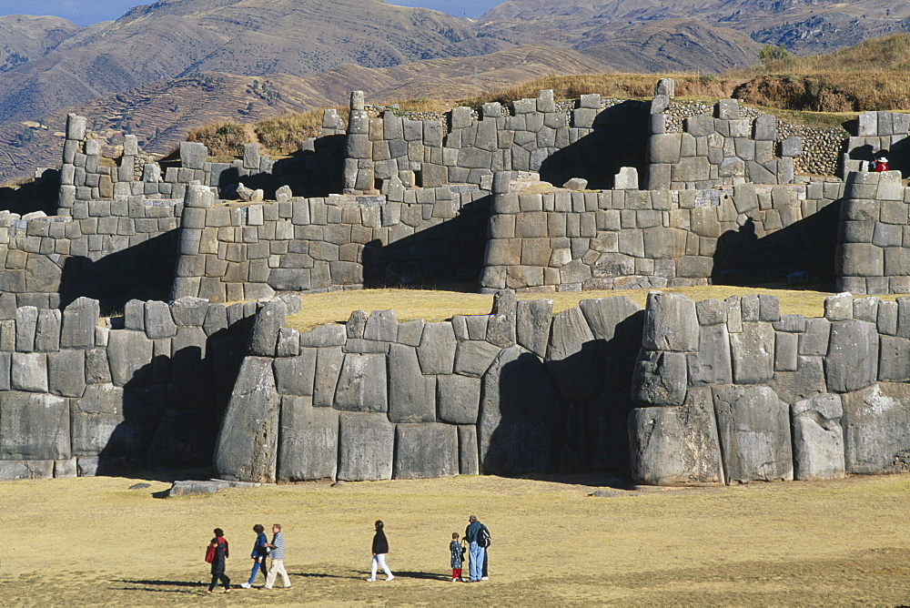 PERU Cusco Department Sacsayhuam‡n People walking infront of the Inca walls.     - 797-817