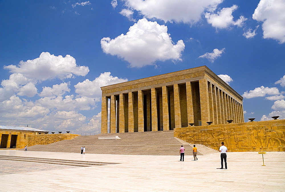 Turkey, Ankara, Anitkabir, Mausoleum of Mustafa Kemal Ataturk the founder of the Turkish Republic and president in 1923 who died in 1938. Monumental rectangular structure set on hilltop with flight of steps to colonnaded entrance. Visitors in middle foreg
