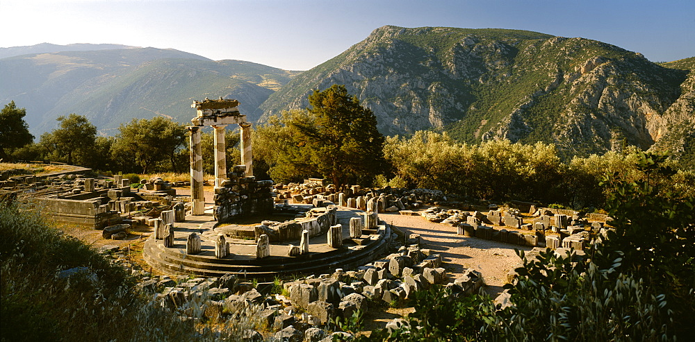 GREECE Central Greece Delphi Sanctuary of Athena.  View over ruins in mountain landscape.
