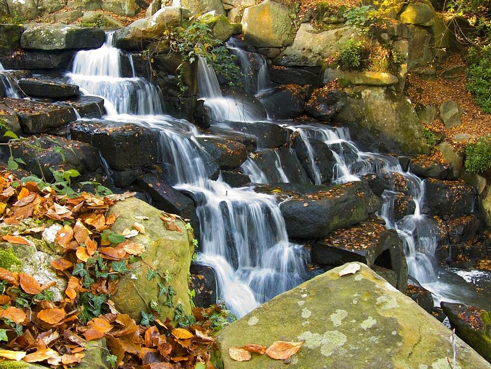 Waterfall in autumn, Virginia Water, Surrey, England