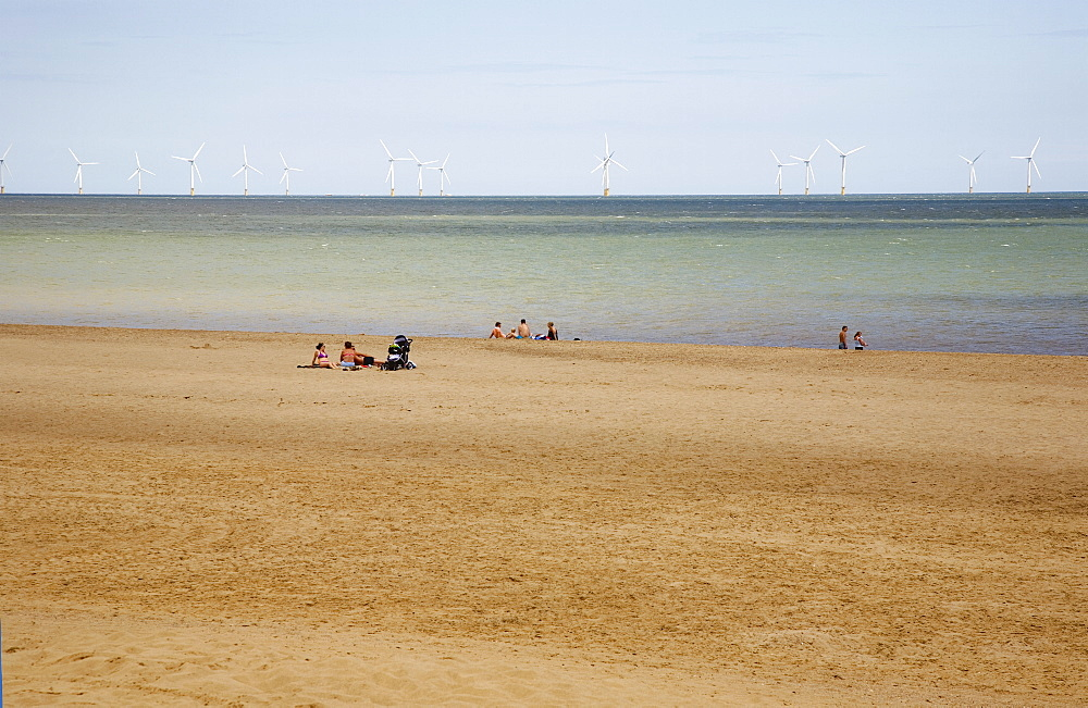 England, Lincolnshire, Skegness, Lincs Wind Farm offshore on the horizon showing turbine blades.