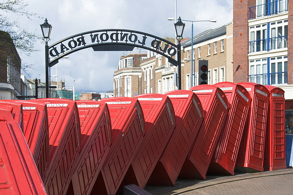 Red telephone box sculpture entitled Out of Order by David Mach, Kingston upon Thames, Surrey, England, United Kingdom, Europe