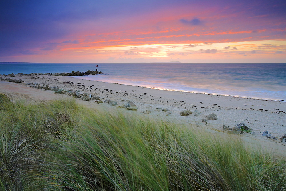 Sunrise over the Christchurch Bay, viewed from Hengistbury Head, Dorset, England, United Kingdom, Europe