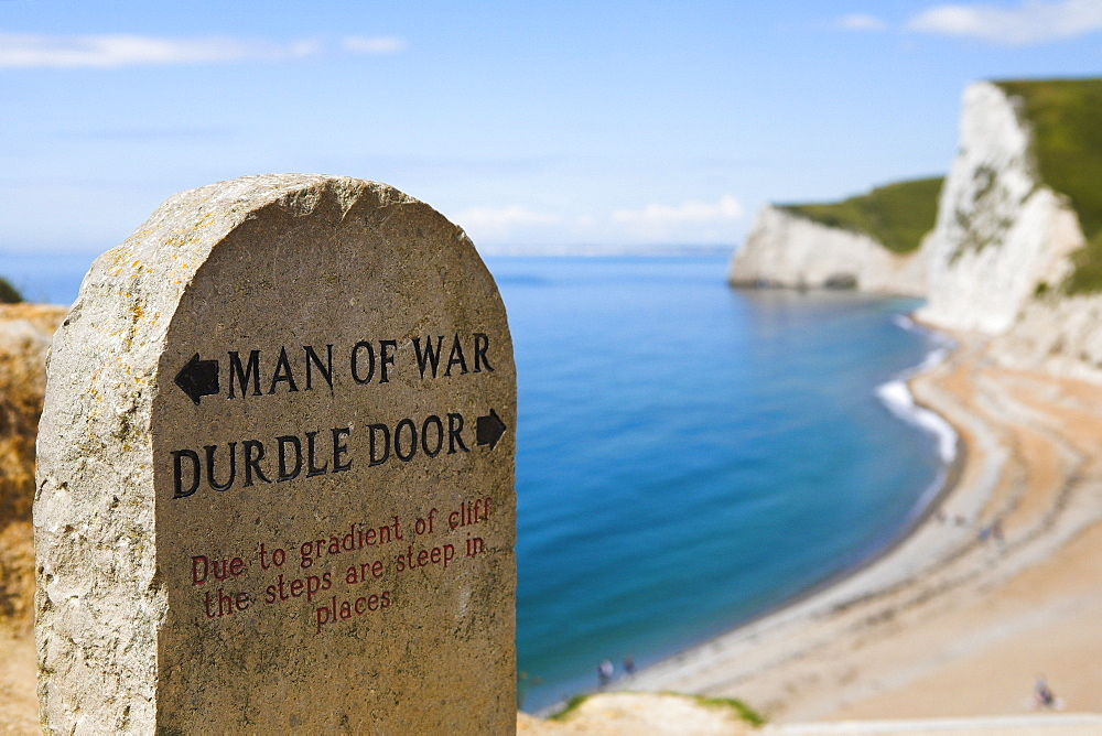 South West Coast Path clifftop signpost, Durdle Door, Jurassic Coast, UNESCO World Heritage Site, Dorset, England, United Kingdom, Europe