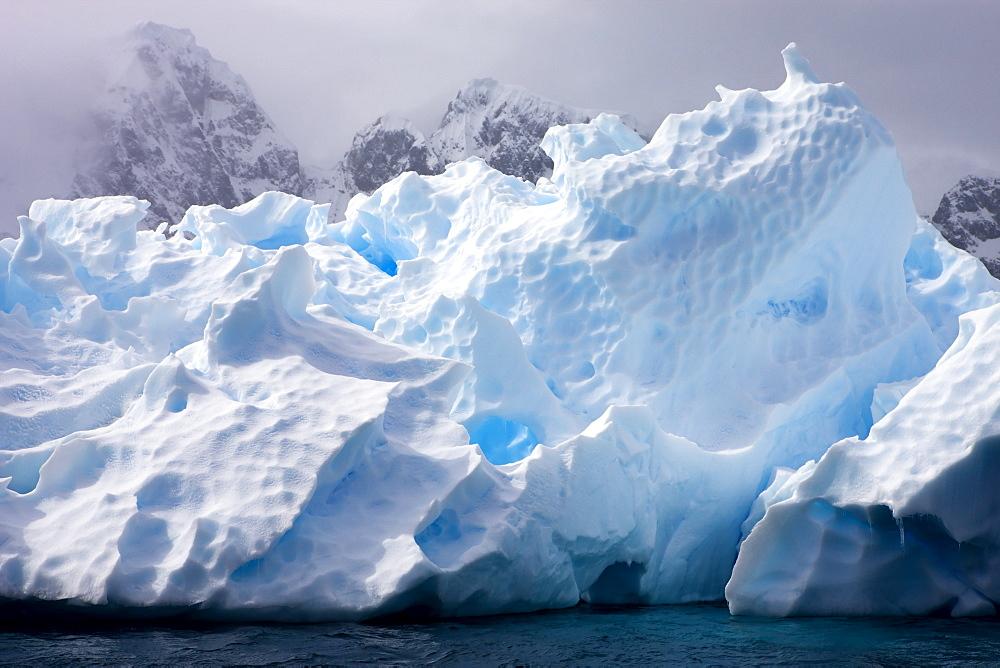 Intricate ice patterns on a weathered iceberg, Pleneau Island, Antarctic Peninsula, Antarctica, Polar Regions