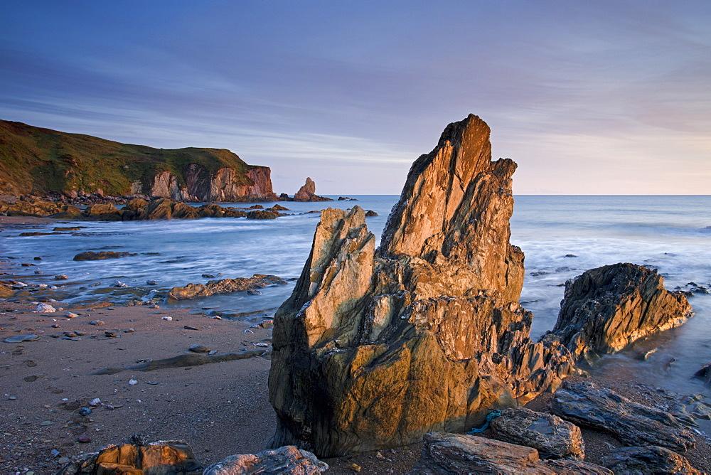 Jagged rocks on the South Devon coast at Bantham, Devon, England, United Kingdom, Europe