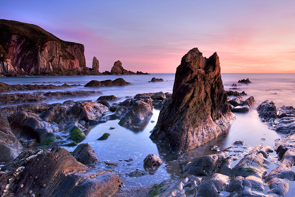 Jagged rocks and cliffs around Bantham in South Devon, England, United Kingdom, Europe