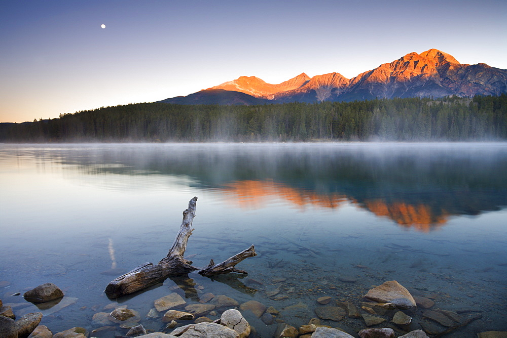 The first rays of sunshine illuminate Pyramid Mountain and reflect in Patricia Lake, Jasper National Park, UNESCO World Heritage Site, Alberta, Canada, North America - 799-1710