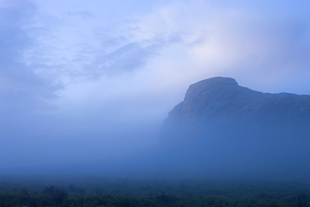 Haytor surrounded by mist on a moody summer evening, Dartmoor National Park, Devon, England, United Kingdom, Europe