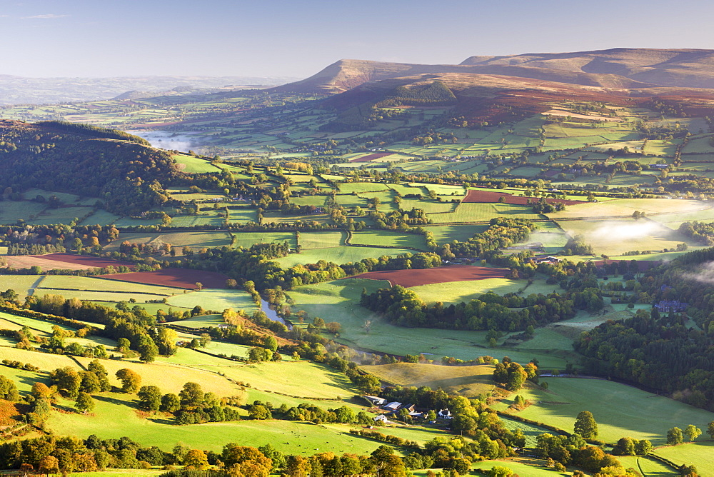 Morning sunshines illuminates the patchwork fields in the Usk Valley, looking towards the Black Mountains, Brecon Beacons, Wales, United Kingdom, Europe