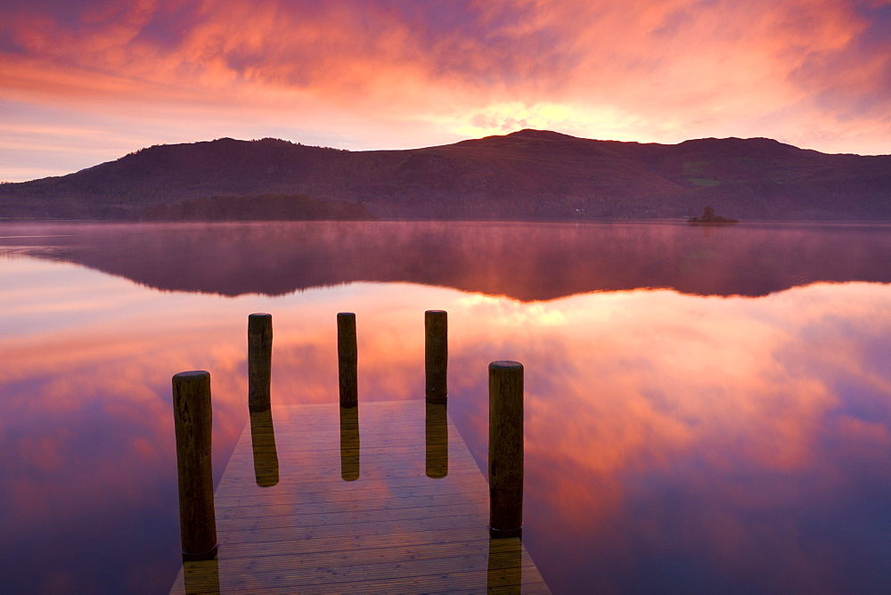 Mist at sunrise over Derwent Water, Lake District National Park, Cumbria, England, United Kingdom, Europe