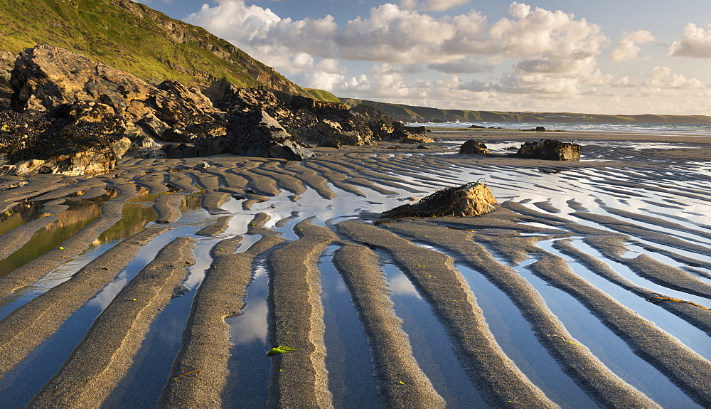 Patterns in the sand at low tide on Tregardock Beach, Cornwall, England, United Kingdom, Europe