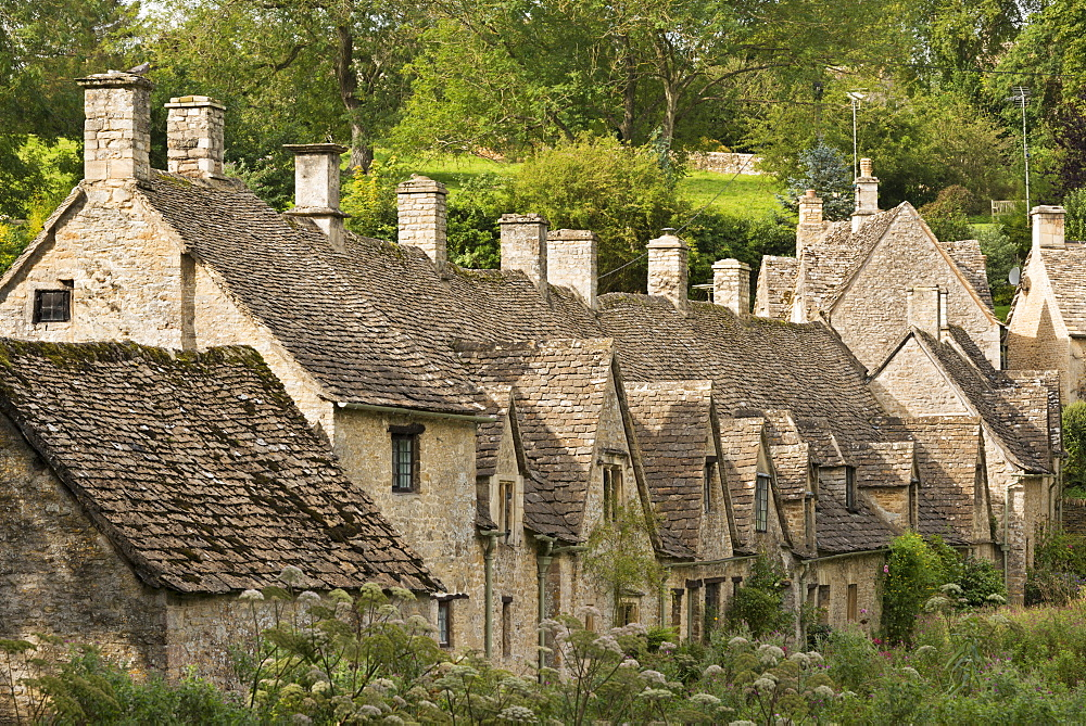 Picturesque cottages at Arlington Row in the Cotswolds village of Bibury, Gloucestershire, England, United Kingdom, Europe