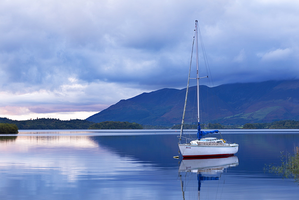 Yacht anchored on Derwent Water at twilight, Lake District National Park, Cumbria, England, United Kingdom, Europe