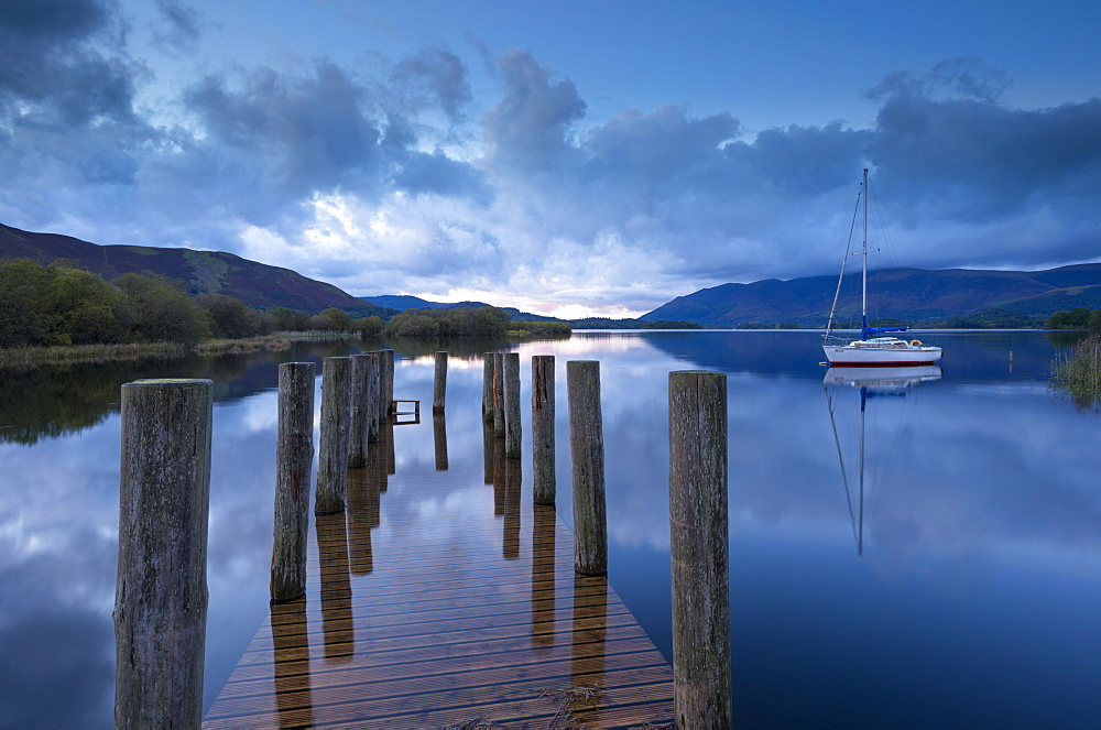 Wooden jetty and yacht on Derwent Water near Lodore, Lake District National Park, Cumbria, England, Great Britain, United Kingdom, Europe