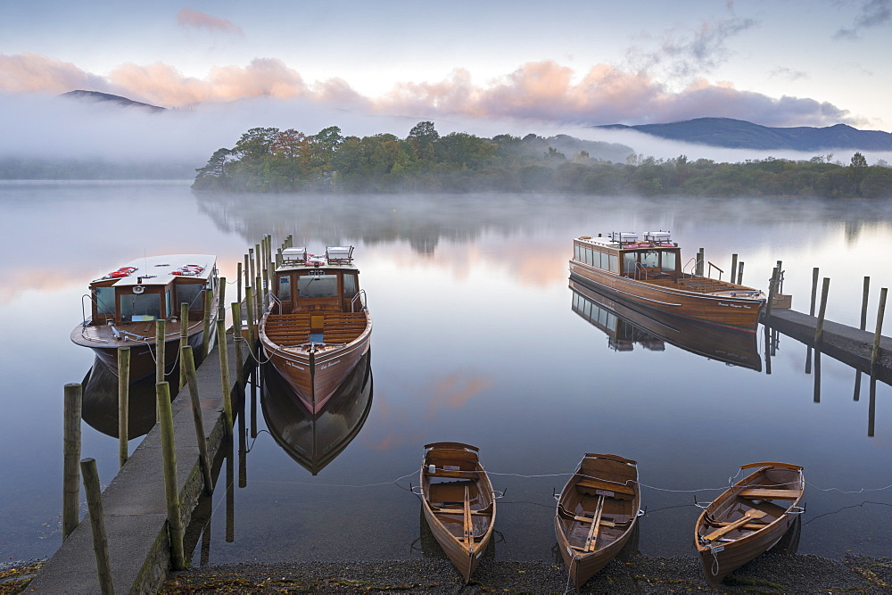 Boats on Derwent Water on a misty autumn morning, Lake District National Park, Keswick, Cumbria, England, United Kingdom, Europe