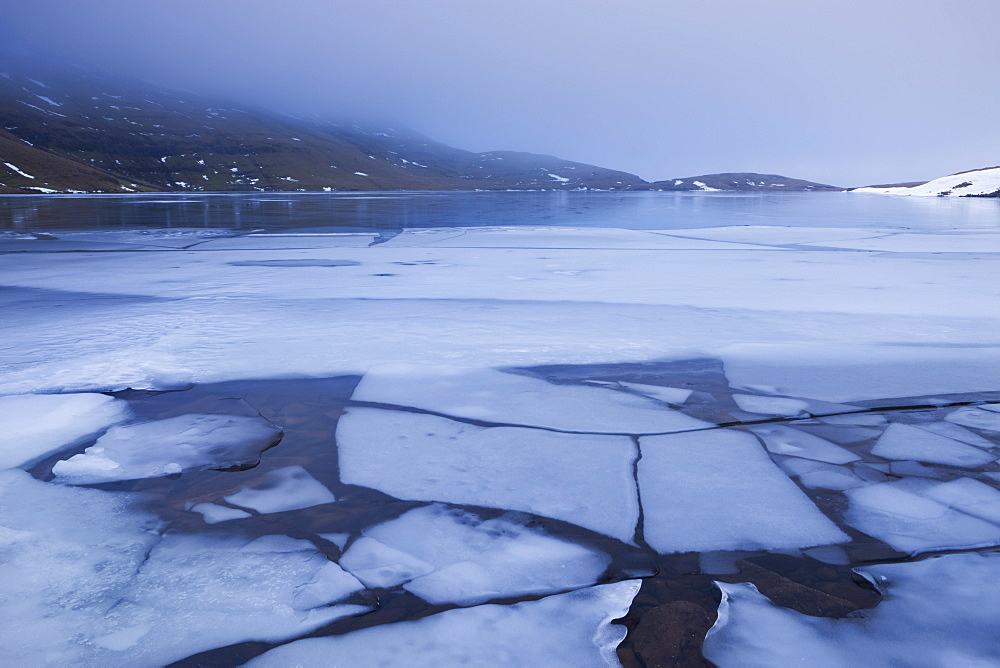 Broken ice on the surface of Llyn y Fan Fawr in the Black Mountains, Brecon Beacons National Park, Wales, United Kingdom, Europe