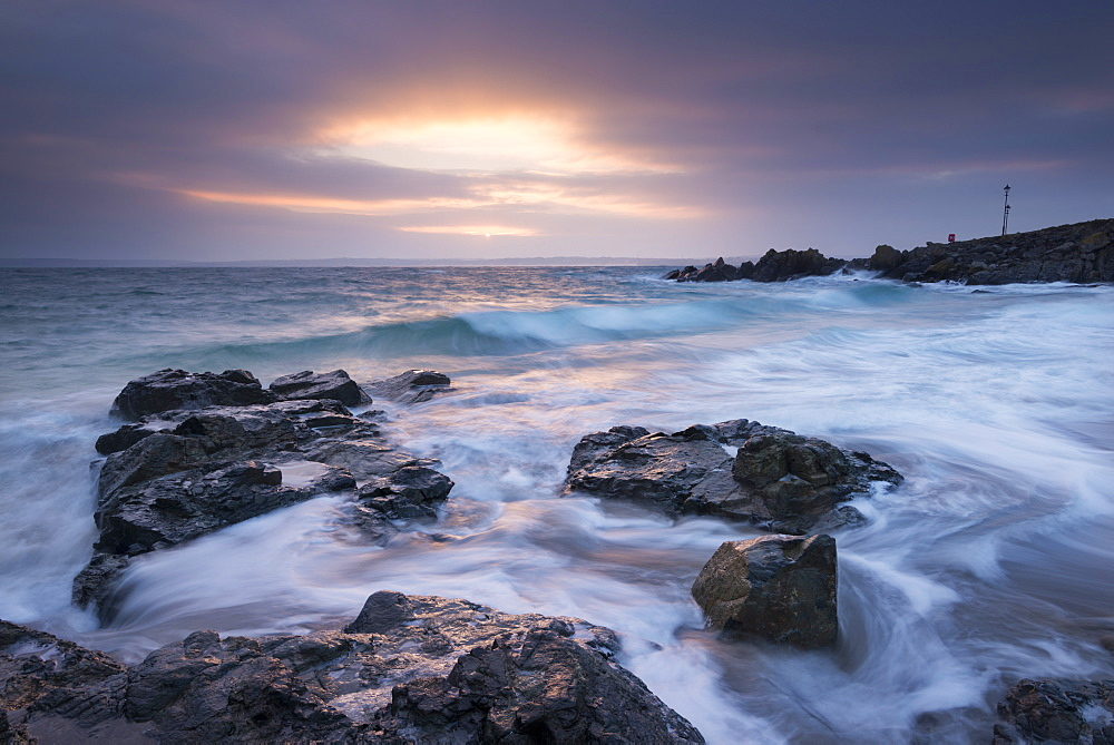 Winter sunrise at Porthgwidden Beach in St. Ives, Cornwall, England, United Kingdom, Europe