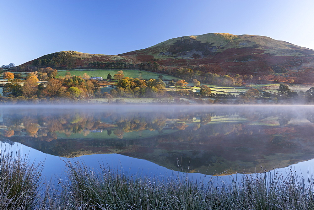 Mist burning off Loweswater on a frosty autumn morning, Lake District National Park, Cumbria, England, United Kingdom, Europe