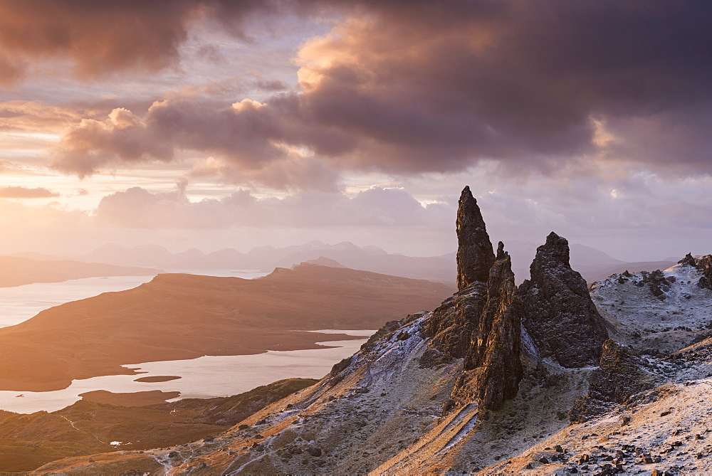 Beautiful sunrise over a snow dusted Old Man of Storr, Isle of Skye, Inner Hebrides, Scotland, United Kingdom, Europe