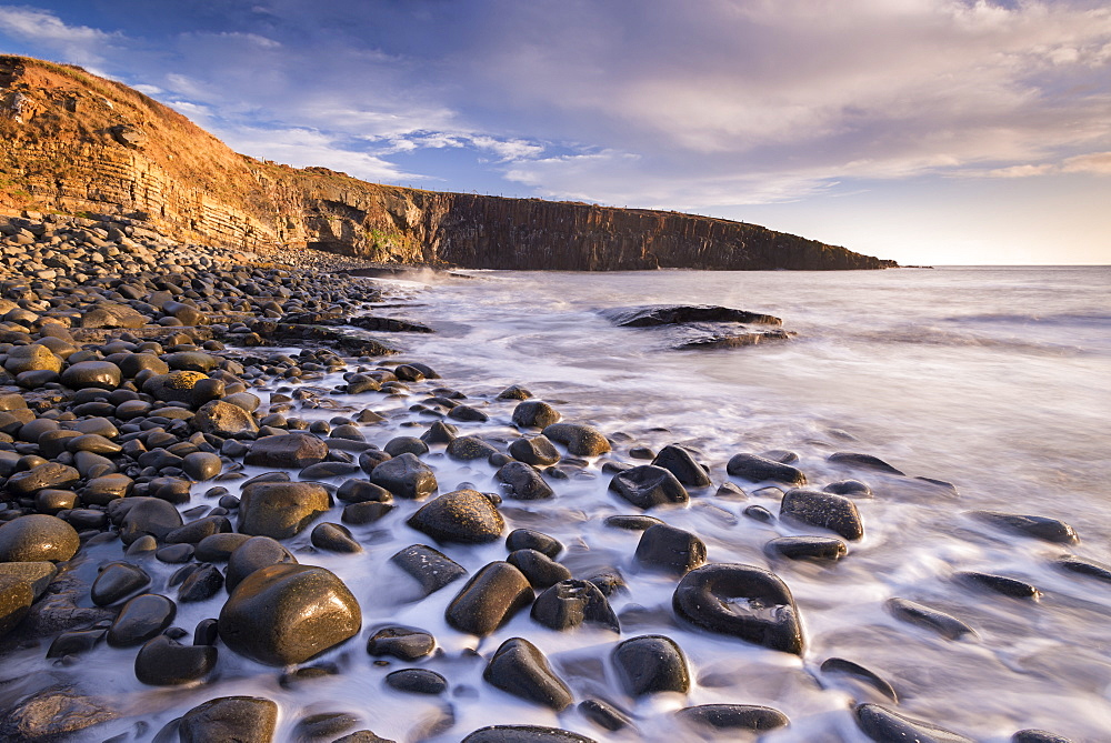 Waves lap against the seashore at Cullernose Point near Howick, Northumberland, England, United Kingdom, Europe