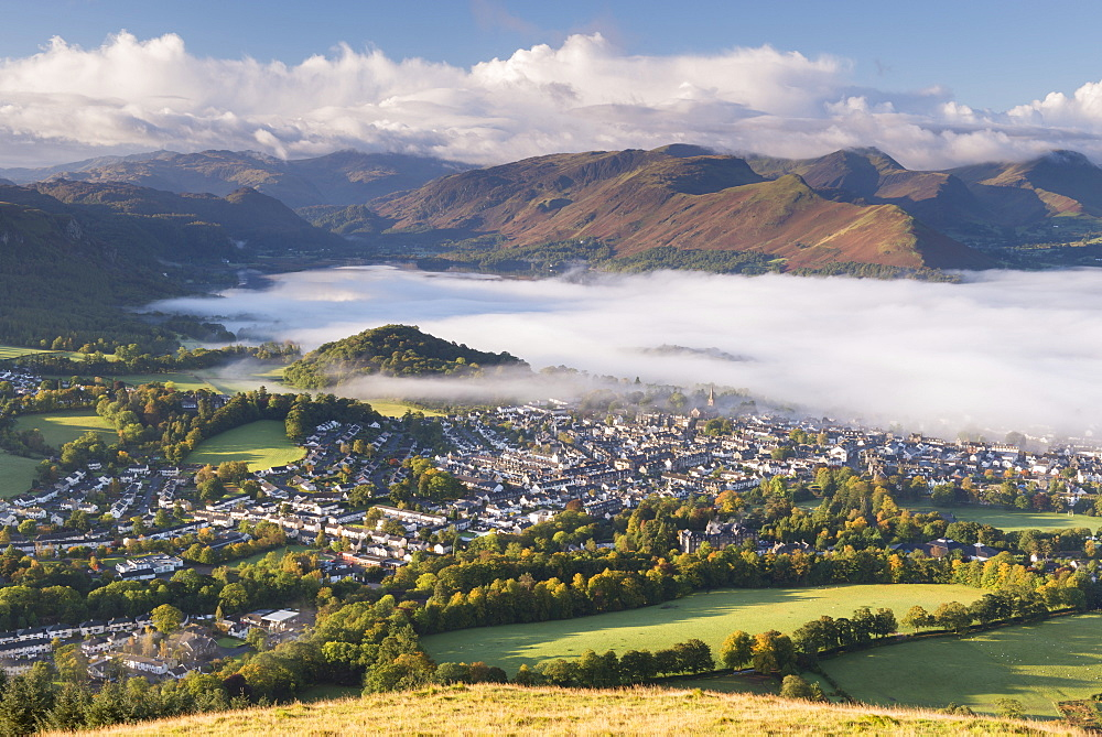 Keswick and mist covered Derwent Water at dawn, Lake District National Park, Cumbria, England, United Kingdom, Europe