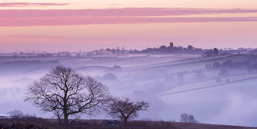 Mist shrouded countryside looking towards the village of Morchard Bishop in winter, Devon, England, United Kingdom, Europe - 799-2740