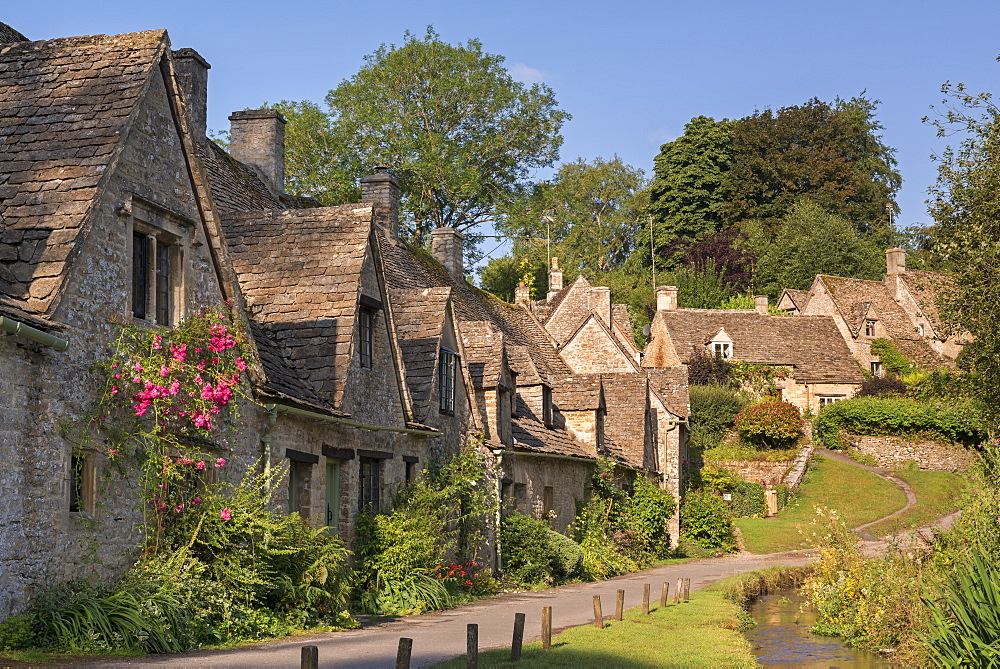 Pretty cottages at Arlington Row in the Cotswolds village of Bibury, Gloucestershire, England, United Kingdom, Europe